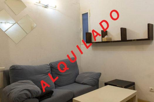 Estudio alquiler calle San Cosme y San Damián | Salón (sofá) | ALQUILADO